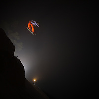 Professional snowboarder Eric Jackson flies through the fog in the middle of the night at Mt. Seymour, just outside of Vancouver, BC, Canada.
