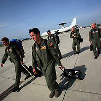 A U.S. flight crew walks the their AWAC plane, a highly sophisticated intelligence gathering plane, in order to prepare for a mission taking off from an airstrip in Manta, Ecuador on April 14, 2008. The Manta air base is the only U.S. base in Ecuador and it is used to conduct drug-trafficking surveillance flights. The Ecuadorian government is looking into the possibility of closing the US base once the lease runs out. (Photo/Scott Dalton).