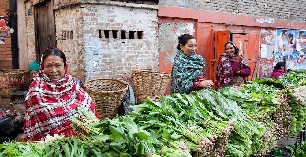 Nepali women selling green vegetables at a market in Kathmandu, Nepal