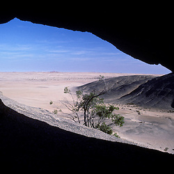 View of the Namib desert from inside a cave, Namibia, Africa