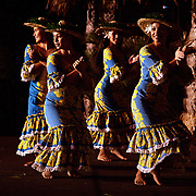 Dancers perform at a Luau in Maui, Hawaii.  Hawaii is one of the top tourist destinations in the world.