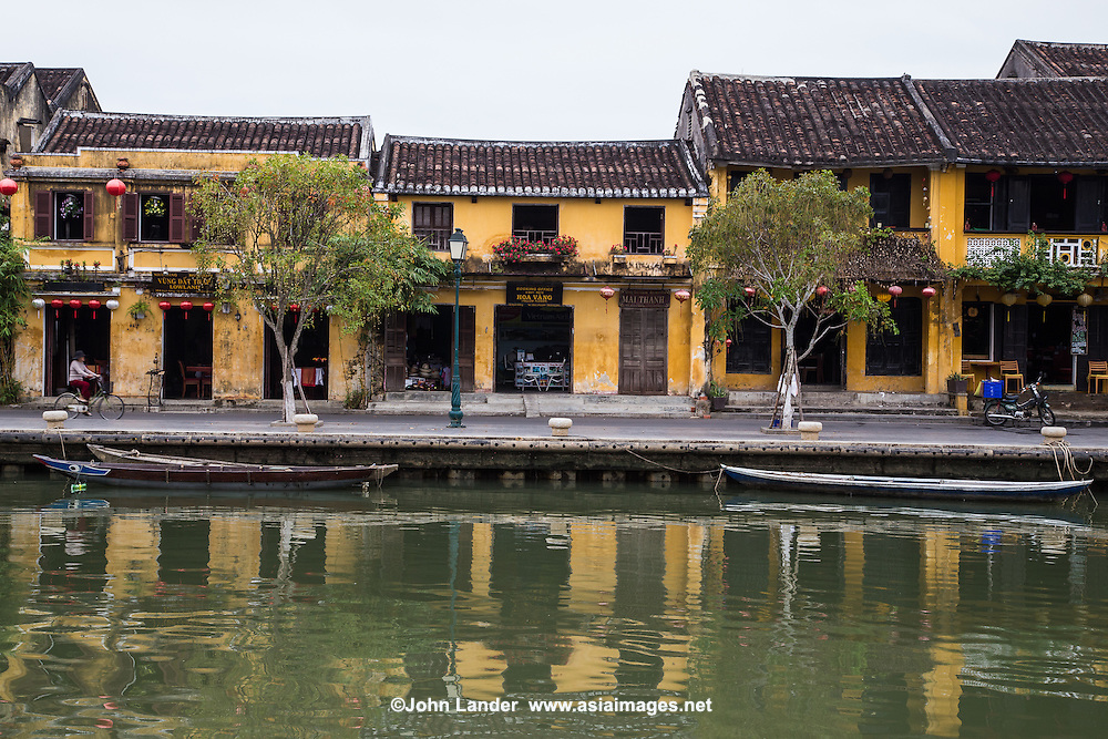 Hoi An Architecture Reflecting on the Thu Bon River - Hoi An Architecture - together with the Chinese and Vietnamese architectural gems, 19th century stucco houses that show both influences from east and west add to the color of this eclectic mixture. Most of these beautiful buildings are well preserved and show an nteresting mix of architecture - all of which gives Hoi An UNESCO World Heritage Status.