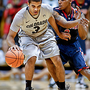 SHOT 2/14/13 8:20:43 PM - Colorado's Xavier Talton #3 tries to fend off Arizona's Mark Lyons #2 during their regular season Pac-12 basketball game at the Coors Event Center on the Colorado campus in Boulder, Co. Colorado won the game 71-58. (Photo by Marc Piscotty / © 2013)
