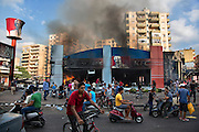 """A KFC and Hardee's restaurant burn after riots break out in Tripoli, Lebanon. The riots were in response to an anti-Islam film, """"Innocence of Muslims,"""" that originated in the U.S. Extremists elements have grown in Lebanon's second biggest city in recent years with Salafists playing an increased military role there."""