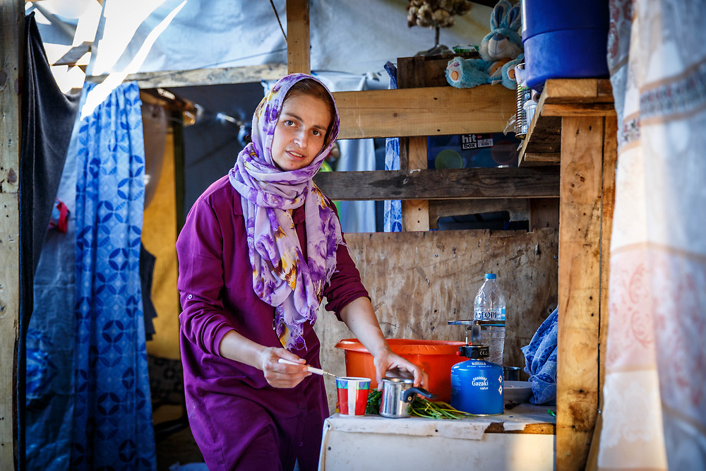 A 28-year-old Syrian mother of four in her makeshift home. Ritsona Refugee Camp, Ritsona, Greece. July 2016.