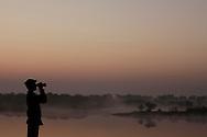 Bird watcher at Chhatra Sagar resort in Rajasthan, India on Dec 30, 2010.<br /> Photo by Kuni Takahashi