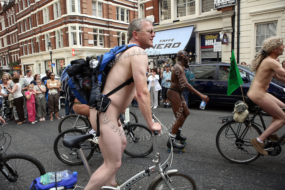 The participants of the World Naked Bike Ride, an event organised in central London, England on Saturday, June 9, 2007, are riding their bike happily undressed. Today hundreds of cyclists and skaters have participated at the ride, protesting against oil dependency and car culture. **Italy Out**