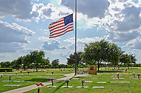 American Flag at half staff in a cemetery with a walk way and trees and luminous clouds in the background Katy, sugarland, richmond, Cinco Ranch, Tomball, Rosenburg, Sienna plantation, Pearland, Houston, Austin, San Antonio, Bryan, The Woodlands, Conroe, Galveston, Beaumont, Victoria, Corpus Christi, Freeport, South Padre Island, Dallas, Professional photographer in areas of Advertising, Architecture, Table Top, Commercial, Real estate, and product Photography. Katy, sugarland, richmond, Cinco Ranch, Tomball, Rosenburg, Sienna plantation, Pearland, Houston, Austin, San Antonio, Bryan, The Woodlands, Conroe, Galveston, Beaumont, Victoria, Corpus Christi, Freeport, South Padre Island, Dallas, Professional photographer in areas of Advertising, Architecture, Table Top, Commercial, Real estate, and product Photography. Katy, sugarland, richmond, Cinco Ranch, Tomball, Rosenburg, Sienna plantation, Pearland, Houston, Austin, San Antonio, Bryan, The Woodlands, Conroe, Galveston, Beaumont, Victoria, Corpus Christi, Freeport, South Padre Island, Dallas, Professional photographer in areas of Advertising, Architecture, Table Top, Commercial, Real estate, and product Photography.