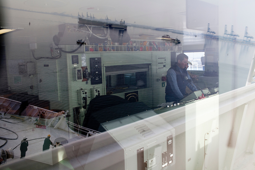 A boat in Baltimore Harbor is reflected in the window of the USNS Comfort, a naval hospital ship, as it gets under way to Haiti to assist earthquake victims.