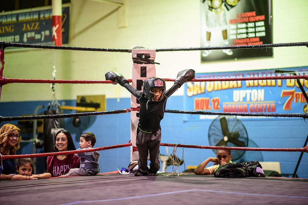 Baltimore, Maryland - January 26, 2017: A young boxer hangs on the ropes at the Upton Boxing Club in Baltimore Thursday January 26, 2017.<br /> <br /> <br /> CREDIT: Matt Roth for The New York Times<br /> Assignment ID: