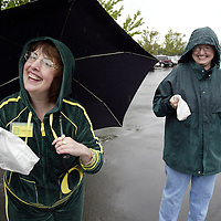 """Oregon Ducks football team prepares for trip and travels to Oklahoma for game against against the Sooners. Members of the """"Daisy Ducks"""" hand out homemade goodies to team as they leave for Oklahoma...Photos © Todd Bigelow/Aurora"""