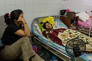 2016/05/29 - Barcelona, Venezuela: Yanire Oca, 14, rests next to her mother, Yanellys Trias in a shared room of the children wing at Dr. Luis Razetti Hospital, Barcelona. Yanire suffers of cancer in the intestine and doesn't have available enough medicine to treat the disease. (Eduardo Leal)