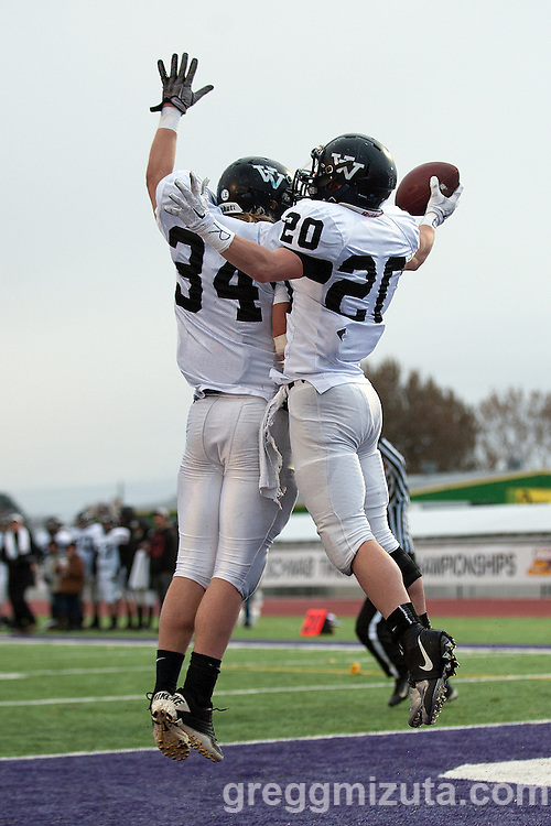 Vale brothers Trace and Lane Cummings celebrate Lane's rushing touchdown for Vale's third score. The touchdown was called back on a penalty, but Lane scored on the following play. Oregon 3A State Championship at Kennison Field, Hermiston, Oregon, November 29, 2014. Vale defeated Harrisburg 45-19 to win the 3A State Championship and finish with a 12-0 season record. <br />