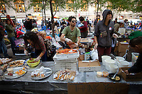 Lunch at the make-shift food center at the  Occupy Wall Street Protest in Zuccotti Park in New York...Photo by Robert Caplin.