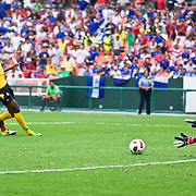 Jamaica Keeper Donovan Ricketts #1(right) makes a driving save in the first half. The United State would go on to to defeat Jamaica 2-0 in the concacaf gold cup quarterfinals Sunday, June 19, 2011 at  RFK Stadium in Washington DC.