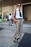 Saida Mouradova.Wearing Prabal Gurung pants, Patrizia Pepe shirt, Christian Louboutin shoes, Marc Jacbos bag, Donald Trump tie.