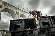 "Preparation - assembling a soundsystem for the ""Rio Parada Funk"" giant yearly party, for once in the traditional district of Lapa, Center of Rio de Janeiro."