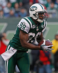 Nov 29, 2009; East Rutherford, NJ, USA; New York Jets wide receiver Jerricho Cotchery (89) returns a kickoff during the second half of their game against the Carolina Panthers at Giants Stadium. The Jets defeated the Panthers 17-6.