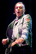 Win Butler of Arcade Fire performs live on stage at O2 Arena on December 1, 2010 in London, England.  (Photo by Simone Joyner)