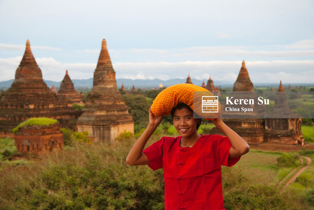 Girl with temples in Bagan, Myanmar