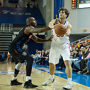 Delaware 87ers Guard Matthew Bouldin (23) attempts to pass the ball as Springfield Armor Guard Larry Anderson (2) defends in the course of a NBA D-league regular season basketball game between the Delaware 87ers (76ers) and the Springfield Armor (Nets) Saturday, Dec. 28, 2013 at The Bob Carpenter Sports Convocation Center, Newark, DE