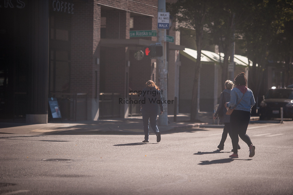 2016 October 11 - Pedestrians cross the, Alaska Junction, West Seattle , Seattle, WA, USA. By Richard Walker
