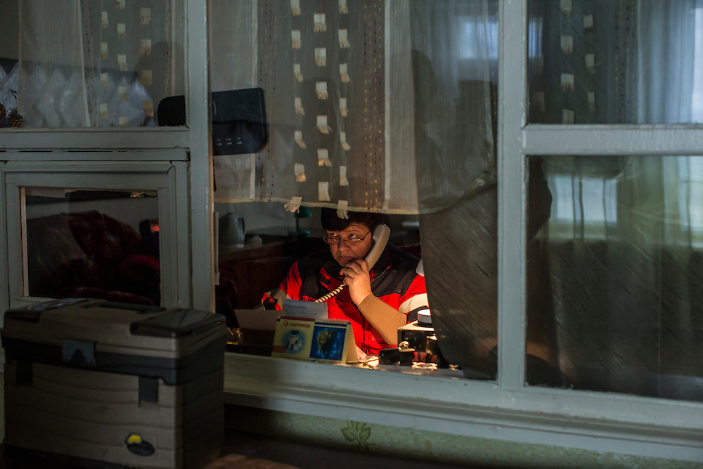 DONETSK, UKRAINE - JANUARY 28, 2015: A dispatcher receives information over the phone for deploying ambulance crews at an ambulance substation the Petrovskyi district of Donetsk, Ukraine. The area, in the city's southwest, is close to heavy front-line fighting in Marinka. CREDIT: Brendan Hoffman for The New York Times