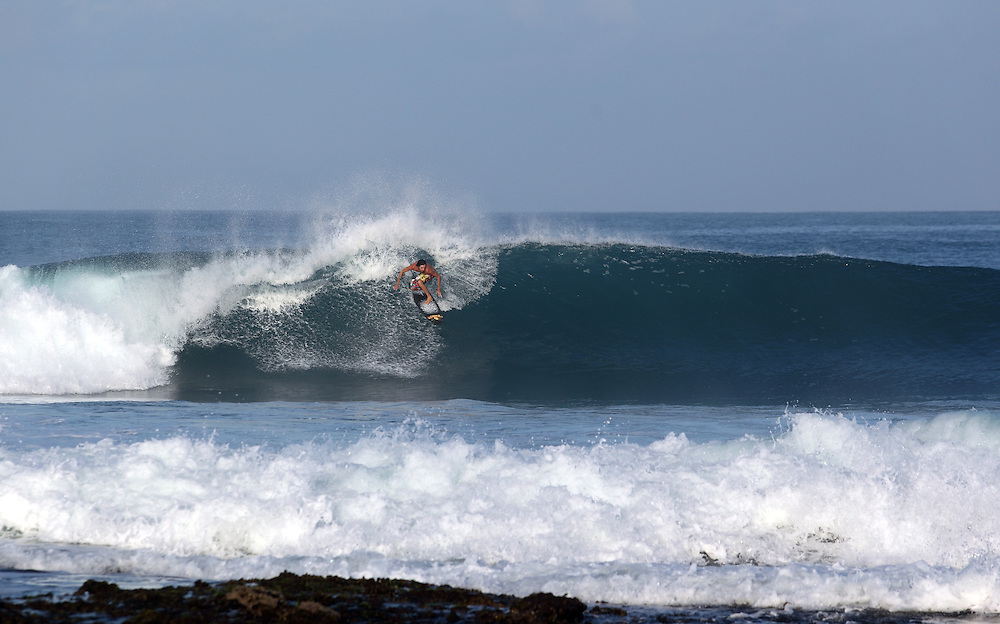 Surfing a wave somewhere in Sumatra.