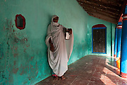 Muslim Woman standing on the veranda of her home in Nagore.