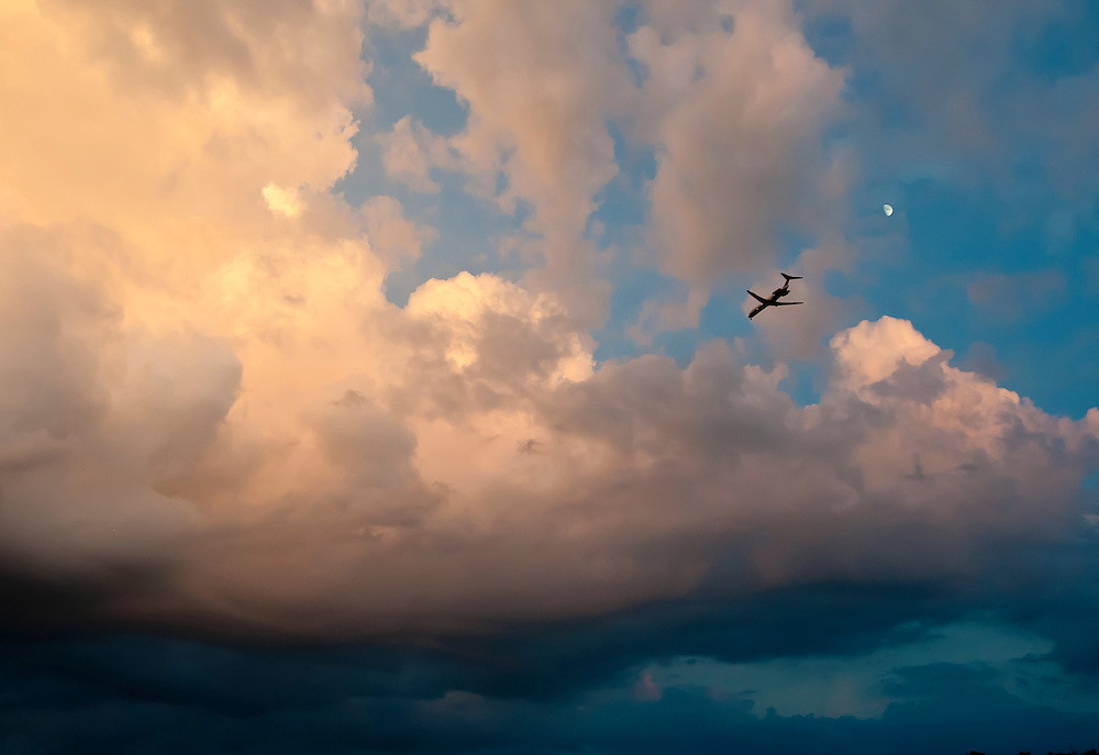 A passenger jet makes its final approach to Washington's National airport following a summer thunderstorm.