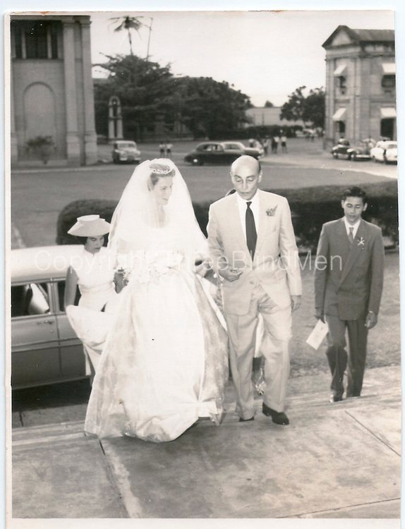 """""""Uncle Hildon and Jean entering the church"""". 1958..Michael Mack on right in a suit. On the back of this print is a rubber stamp with the name Felsinger, photographer, Peradeniya Road, Kandy."""