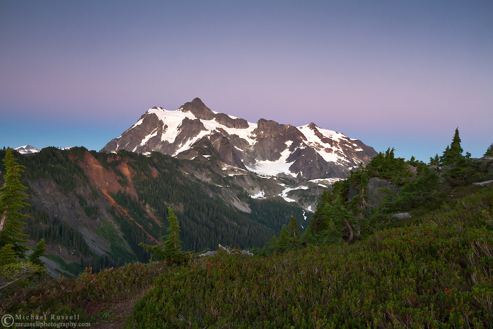 """After direct sunlight/alpenglow had left Mount Shuksan, this band of purple and blue known as the """"Belt of Venus"""" rose in the sky.  Photo made from Kulshan Ridge in the Mount Baker-Snoqualmie National Forest in Washington State, USA."""