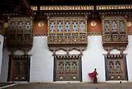 A monk walks at the Punakha Dzong, also known as Pungtang Dechen Photrang Dzong, in Punakha, Bhutan on September 3, 2013. The dzong, used as the administrative centre and monastery, was constructed by Zhabdrung Ngawang Namgyal in 1637 and the second oldest and second largest temple in Bhutan.<br /> (Photo by Kuni Takahashi)