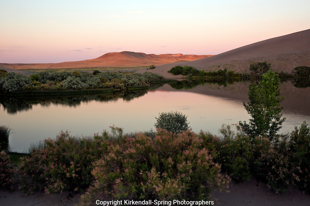 ID0650-00...IDAHO - Sunset over one of the Dune Lakes at Bruneau Dunes State Park.