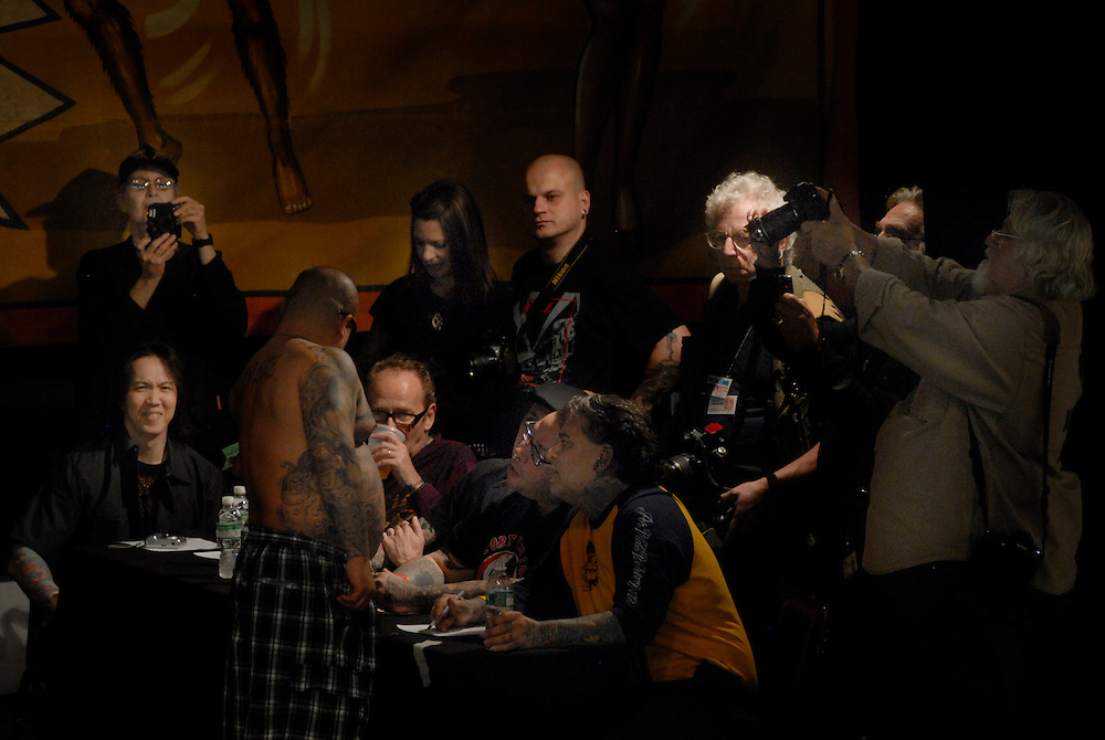 New York City Tattoo Convention 2009 at the Roseland Ballroom:  The Judges inspect the best of the day Tommy Shaun, BillSalmon, Jeremy Miller, Frank Romano and Uncle Needles