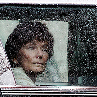 Natalie Jacobson looks out the rainy window of her limo following the funeral of her  former husband and co-anchor Chet Curtis at St. Cecilia's Church, Monday, January 27, 2014.