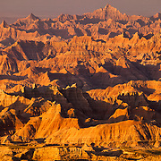 The Pinnacles, a large cluster of particularly rugged formations in Badlands National Park, South Dakota, is turned golden at sunrise.