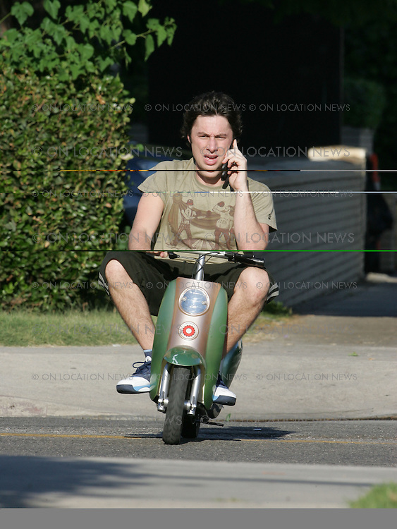 August 22, 2006 Los Angeles, CA Zach Braff Chats on his cell phone while driving himself from his trailer to the set of Scrubs on a mini scooter. Exclusive Photo By Eric Ford 1/818-613-3955 info@onlocationnews.com