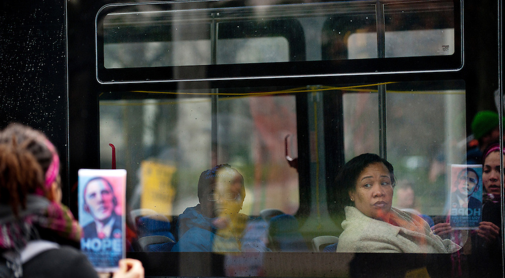 Passengers on a Metro bus look on as protestors rally in Washington, D.C. to demand that President Obama keep his promise and shut down the U.S. controlled detention center at Guantánamo Bay, Cuba. ..January 11, 2012, marks 10 years since the first detainees were transferred to Guantánamo. According to U.S. authorities, 779 detainees have been held in Guantánamo, the vast majority without being charged or granted a criminal trial. Presently there are 171 prisoners held there.