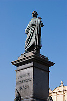 statue of Adam Mickiewicz and the Cloth Hall in Krakow Poland