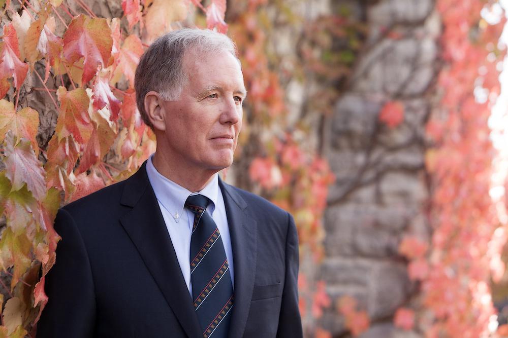 Casual photos of Chancellor Jim Leech beside Ontario Hall in the fall