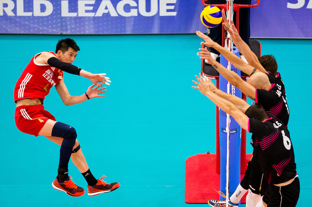Chen Zhang of China spikes the ball versus Portugal at a World League Volleyball match at the Sasktel Centre in Saskatoon, Saskatchewan Canada on June 24, 2016.
