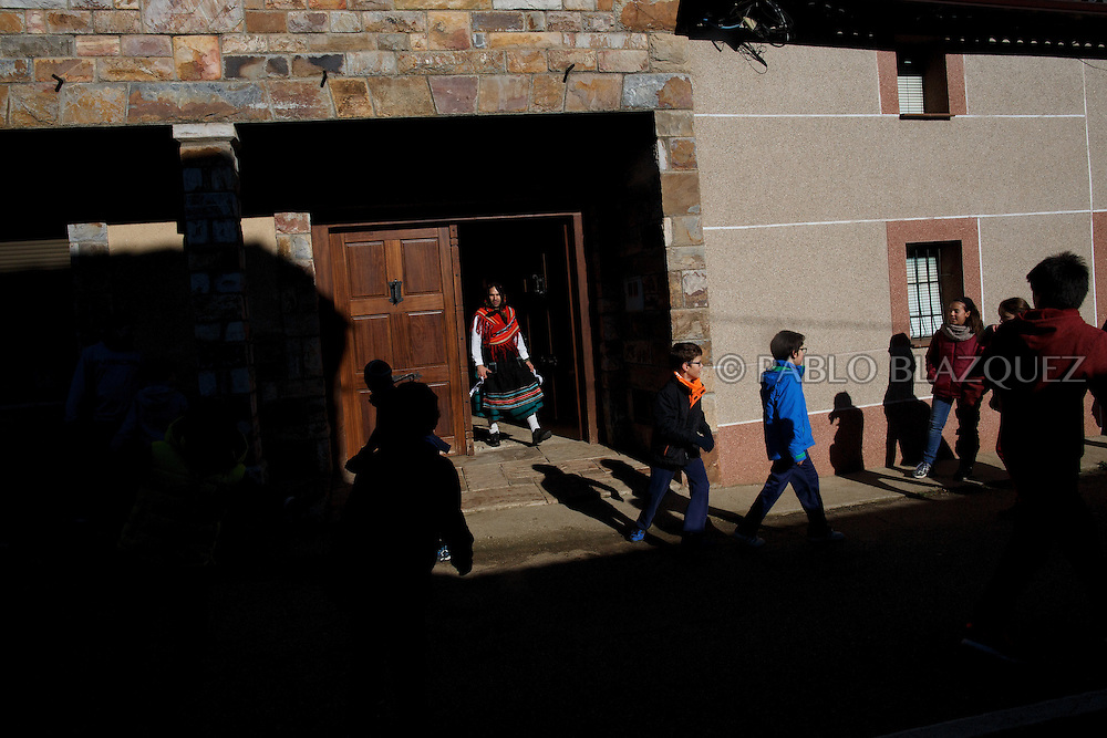 A man dressed as La Madama (madame) leaves a house during La Filandorra festival on December 26, 2016 in the small village Ferreras de Arriba, Zamora province, Spain.  La Filandorra festival is a pagan winter masquerade that takes place during Saint Esteban festivities. The parade is represented by four characters, La Filandorra, El Diablo (Devil), La Madama (madame) y El Galán (Gallant). (© Pablo Blazquez)