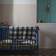 A child's cot and toys in Villa Artemis, a shelter for 30 refugee women and their children in the grounds of Leros Hospital.<br /> <br /> Opened in September 2015, the shelter was run by the Leros Solidarity Network. However, Villa Artemis was closed down shortly after the opening of a 'Hotspot' (EU-run migrant's reception centres) camp in Lepida in February 2016.