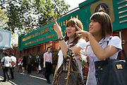 Wittaya Jannoi (21) a marketing student and Watchara Sathongpein (21) a general management .student, in front of the entrance of Suan Dusit university..In Suan Dusit University in Bangkok, ladyboys feel free to be themselves by getting dressed in .girls' uniforms and behaving in a feminning way. The University's policy of accepting them as .equal to other students, has made it so popular that it now has about 100 transgender students .studuing in it's faculties.