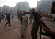 Rebel Libyan fighters take control of the pro- Muammar Gaddafi neighborhood of Abu Salin in Tripoli, Libya August 25,2011.  Rebel fighters tried nearly every weapon they had to fight against Gaddafi loyalist still trying to resisit .(Photo by Heidi Levine/Sipa Press).