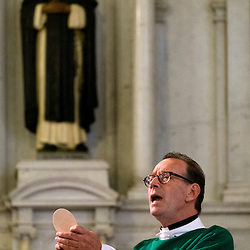 2 AUG. 2015 -- ST. LOUIS -- Father Tim Cook, pastor at Sts. Teresa and Bridget Catholic Parish in St. Louis, prepares for Communion during Mass Mob III Sunday, Aug. 2, 2015. The event brings Catholics from across the Archdiocese of St. Louis to worship at historic, urban parishes.<br /> <br /> Photo by Sid Hastings.