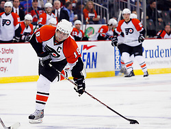 Oct 24, 2008; Newark, NJ, USA; Philadelphia Flyers center Mike Richards (18) takes a shot during the third period at the Prudential Center. The Flyers defeated the Devils 6-3.