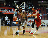 "Ole Miss' Jarvis Summers (32) drives against Louisiana-Lafayette's Raymone Andrews (22) at C.M. ""Tad"" Smith Coliseum in Oxford, Miss. on Wednesday, December 14, 2011. (AP Photo/Oxford Eagle, Bruce Newman)"