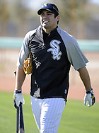 GLENDALE, AZ - FEBRUARY 23:  Carlos Quentin #20 of the Chicago White Sox looks on during a spring training workout on February 23, 2010 at the White Sox training facility at Camelback Ranch in Glendale, Arizona. (Photo by Ron Vesely)